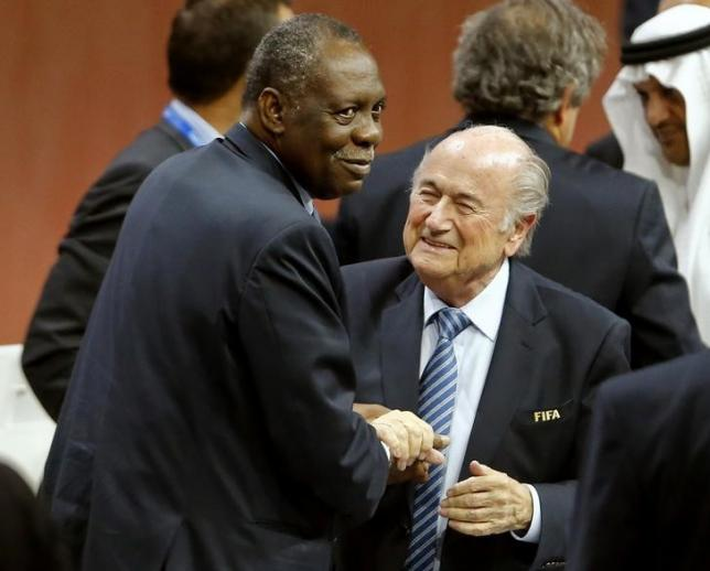 Issa Hayatou (L), Senior Vice President of the FIFA, congratulates FIFA President Sepp Blatter after he was re-elected at the 65th FIFA Congress in Zurich, Switzerland, in this May 29, 2015 file photo. Photo: REUTERS
