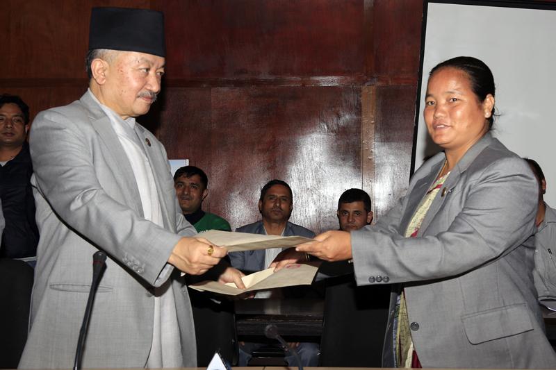 Speaker Subas Chandra Nembang (left) and Deputy Speaker Onsari Gharti submit their resignation to each-other, in Kathmandu, on Wednesday, October 14, 2015. Photo: RSS