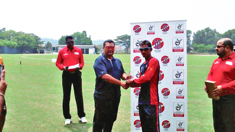 Nepalu2019s Sunil Dhamala receives man-of-the-match trophy from a ICC representative after the U-19 World Cup nQualifier match against Papua New Guinea on Thursday.