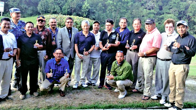 Winners of the third NRN Friendship Golf Tournament hold their trophies at the Gokarna Golf Club in Kathmandu on Sunday. Courtesy: Gokarna Golf Club