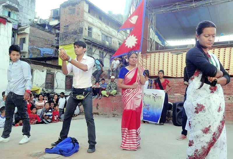 Artistes of the Achel Theatre Group performing a street drama at Basantapur Dabali in Kathmandu, on Saturday, October 3, 2015. Photo: Achel