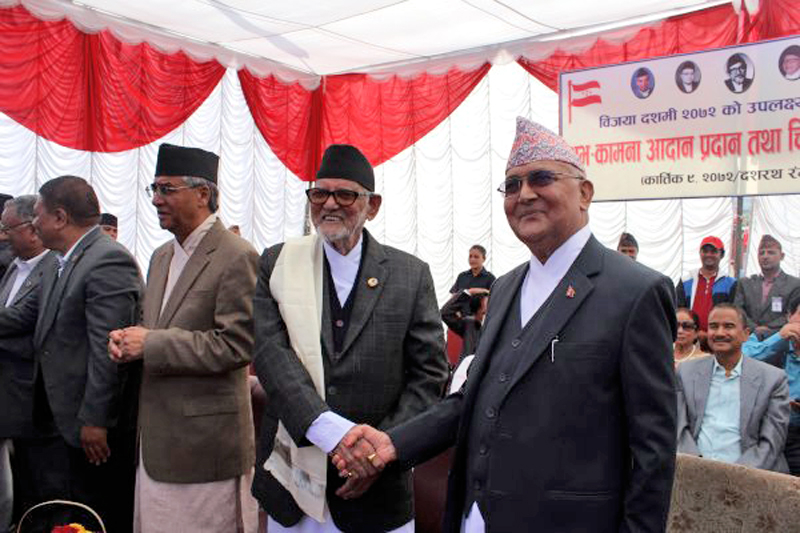 FILE: The then Prime Minister KP Sharma Oli shaking hands with Nepali Congress President Sushil Koirala at a tea party organised by the Nepali Congress at Dashrath Stadium, Tripureshwor on Monday, October 26, 2015. Photo: PM's twitter account
