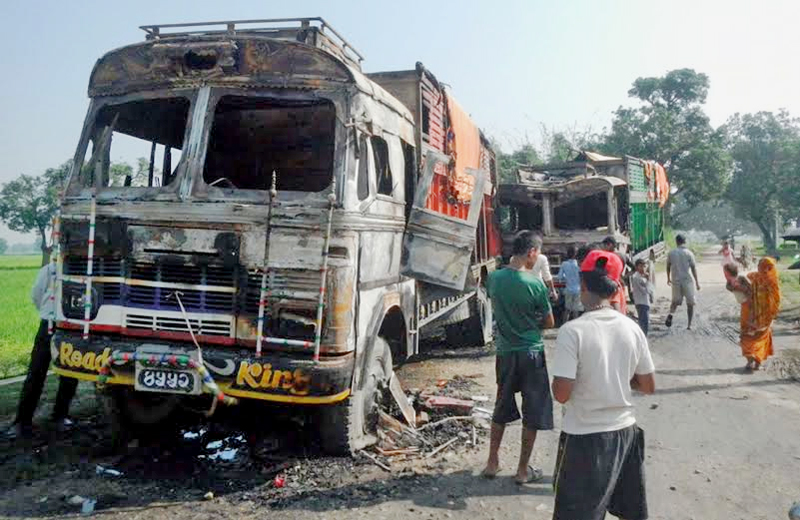 Two trucks torched by the cadres of United Democratic Madhesi Front in Birgunj on Tuesday, October 6, 2015. Photo: Ram Sarraf