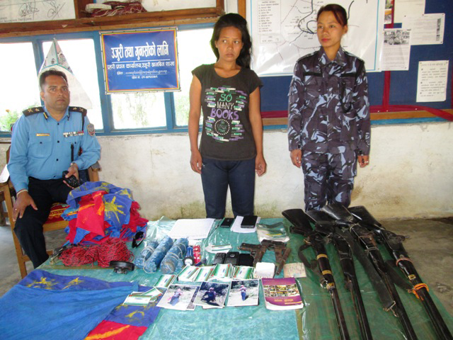 Police parade Mana Kumari Chongwang (33), who was held with a huge cache of arms, in Phidim of Panchthar, on Saturday, October 17, 2015. Photo: Laxmi Gautam