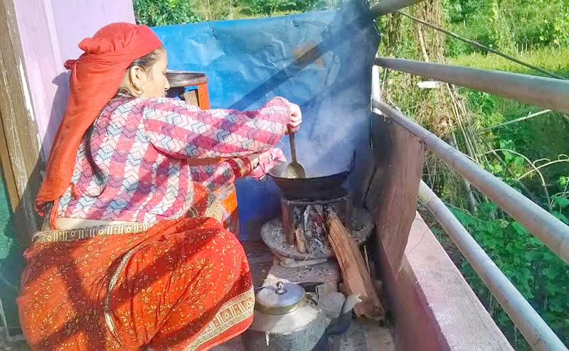 A woman making food using firewood after the shortage of cooking gas in Kusma Municipality of Parbat district, on Sunday, October 25, 2015. Photo: Tilak Rimal