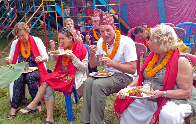 Tourists enjoying nepali cousine after receiving Bhaitika on the occasion of Tihar Festival in Pokhara. Photo: Rup Narayan Dhakal