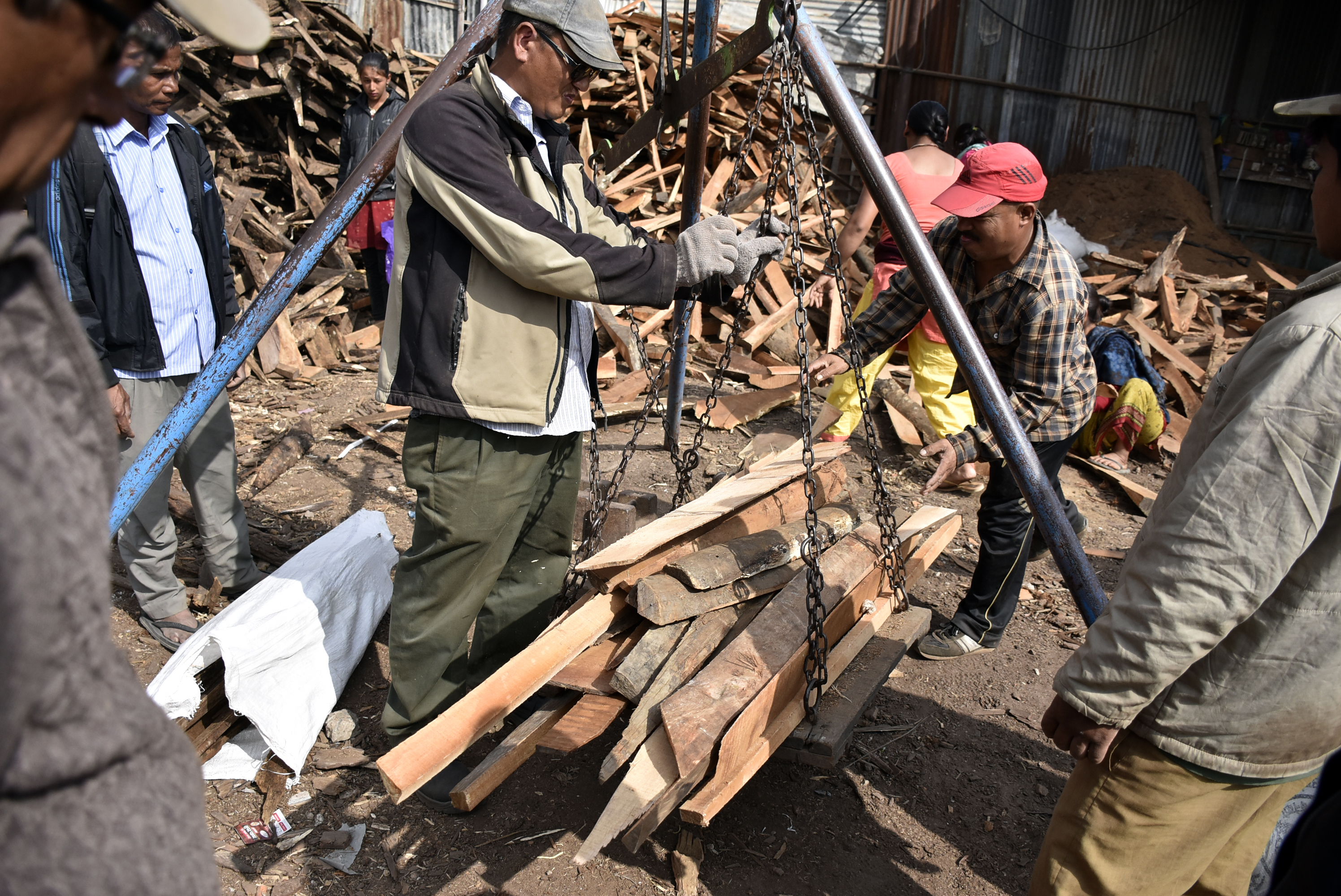 depot staffers weighing firewood, in Gwarko, Lalitpur, on Sunday.
