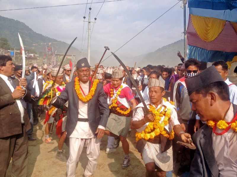 Participants of Saran Festival demonstrate their sword skills during the Saraya Nach Competition, in Pyuthan district on Saturday, November 14, 2015. Photo: Devendra Barma
