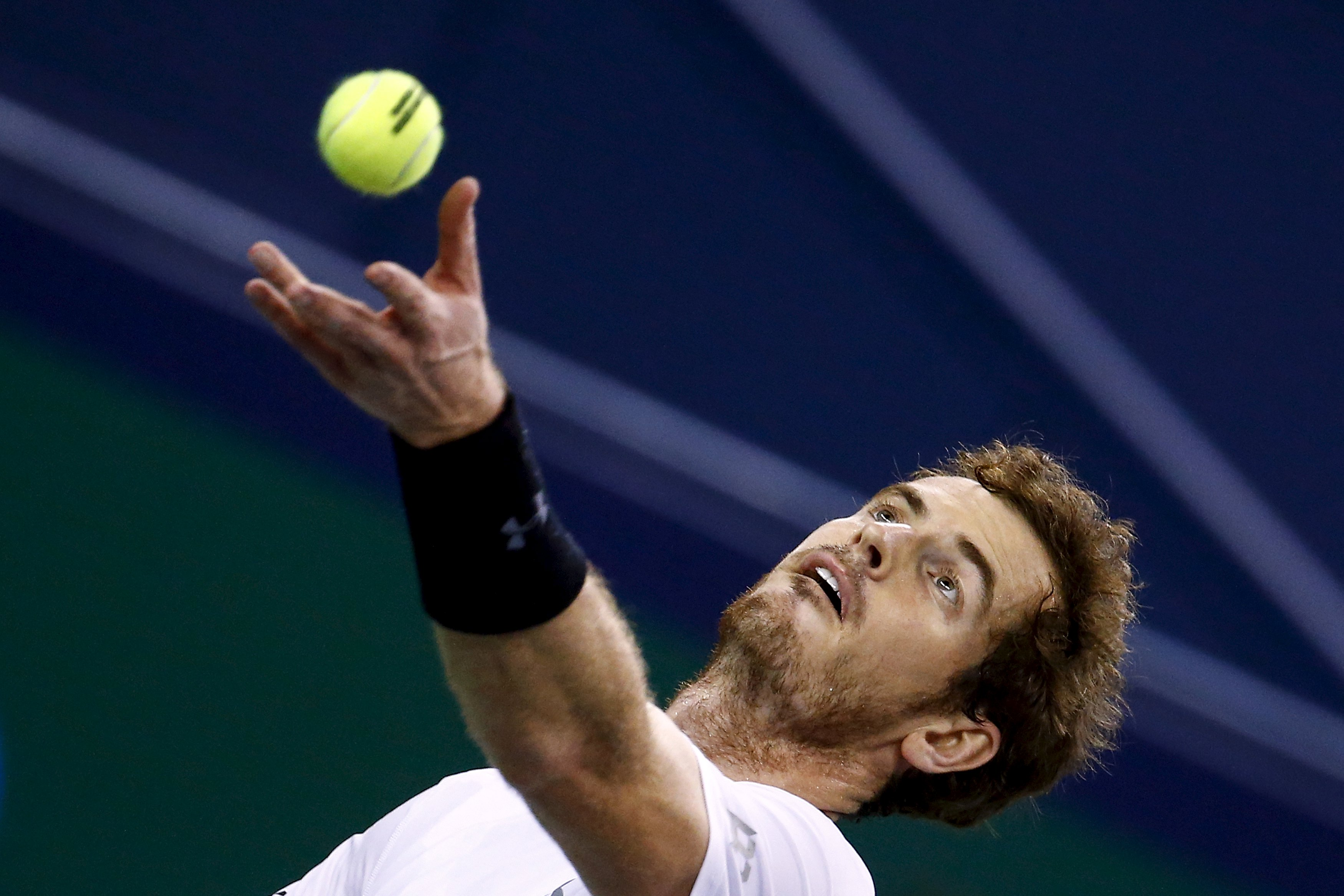 Andy Murray of Britain serves the ball as he plays against Novak Djokovic of Serbia in their men's singles semi-final match at the Shanghai Masters tennis tournament in Shanghai, China, October 17, 2015. REUTERS/Damir Sagolj