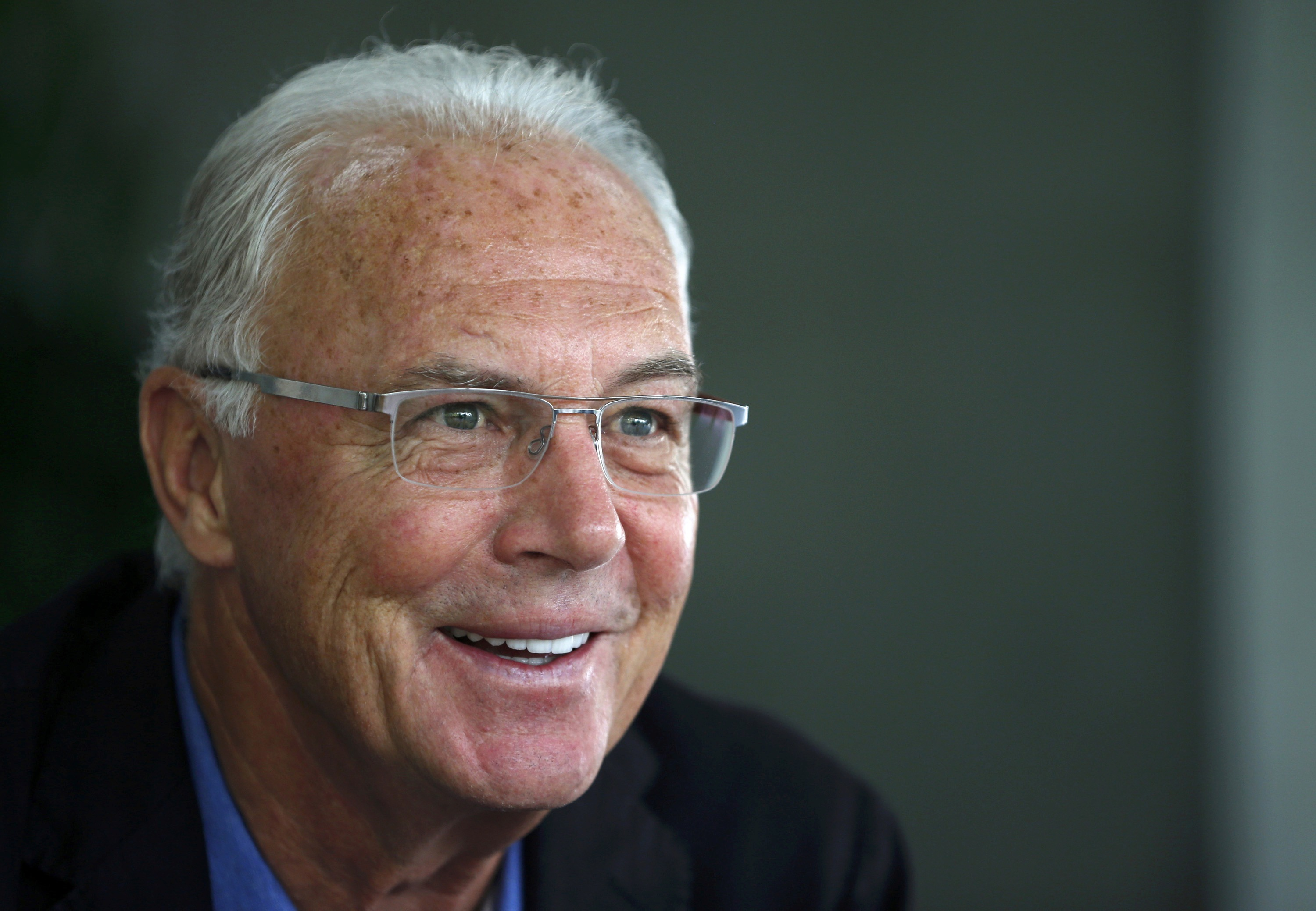 File photo of former FIFA executive committee member Franz Beckenbauer speaking to the media during a news conference in Seoul June 3, 2013. Photo: Reuters