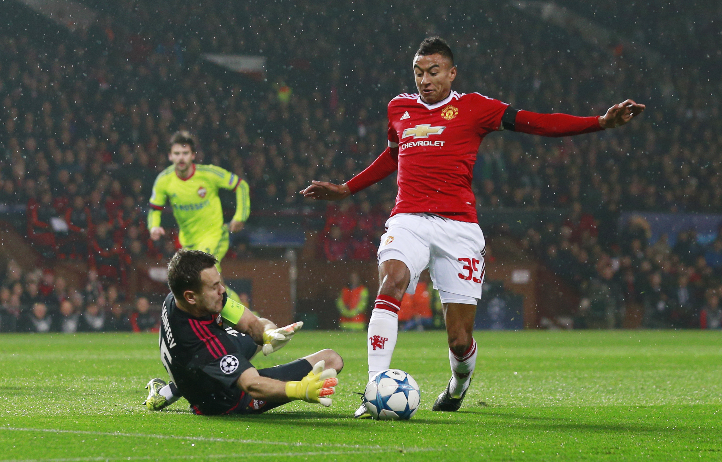 Manchester United's Jesse Lingard and CSKA Moscow's Igor Akinfeev in action during UEFA Champions League game at Old Trafford on November 3, 2016. Photo: Reuters
