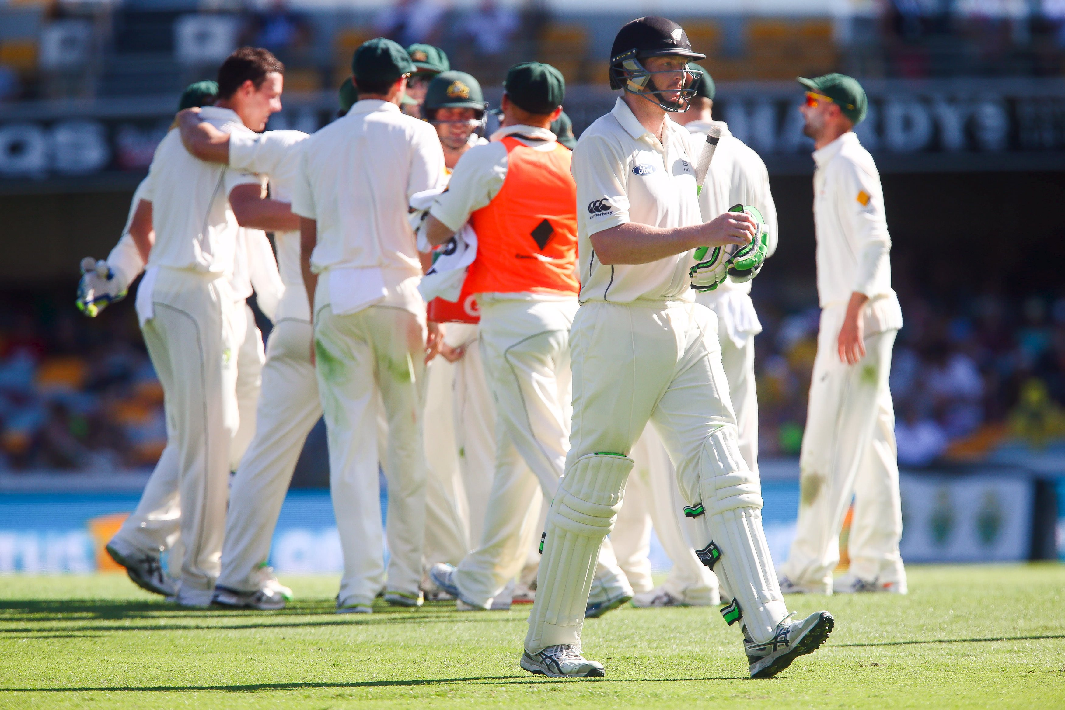 New Zealand batsman Martin Guptill departs after being dismissed by Australian bowler Josh Hazlewood during the first cricket test match between Australia and New Zealand in Brisbane November 6, 2015. REUTERS/Patrick Hamilton