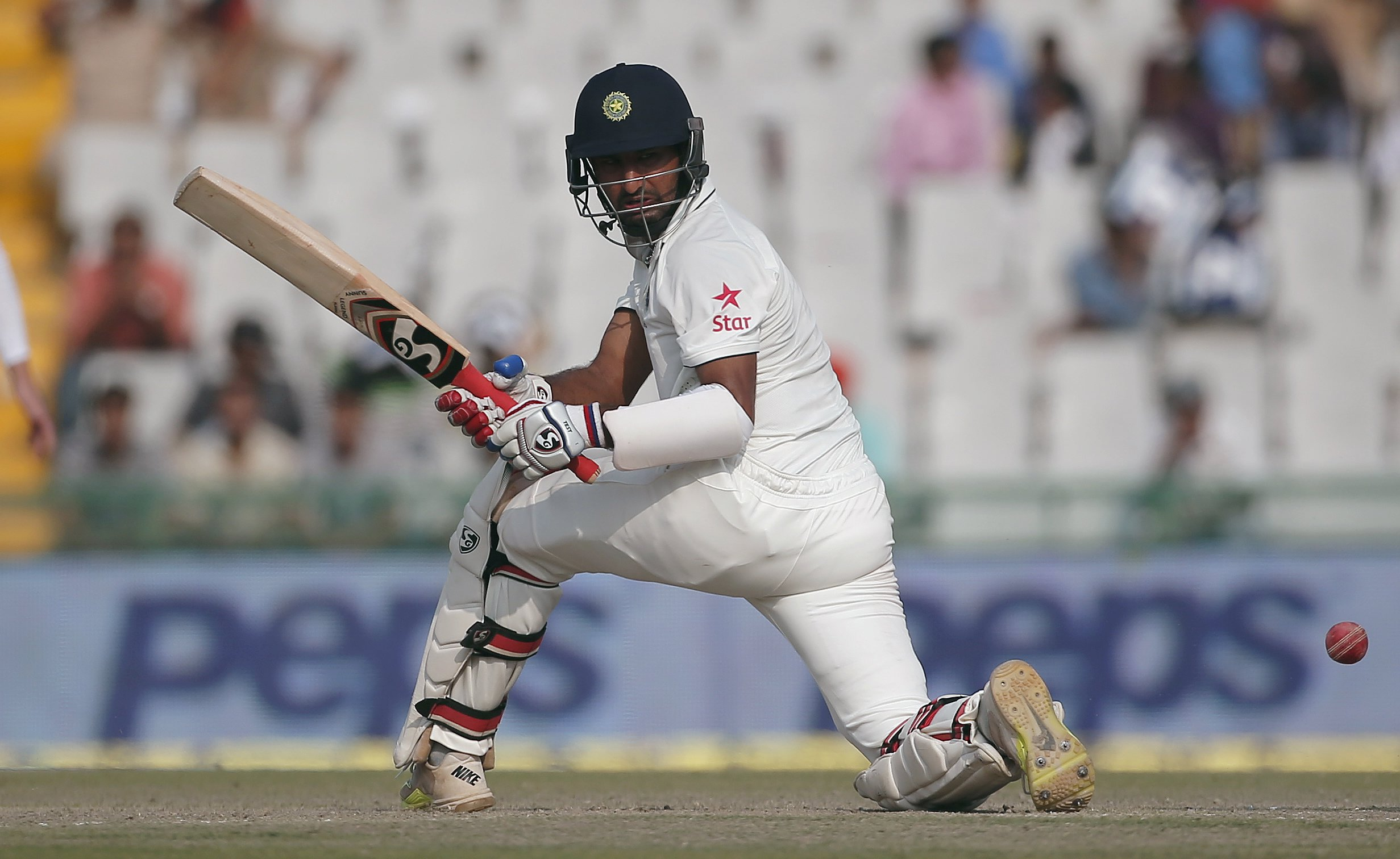 India's Cheteshwar Pujara plays a shot during the second day of their first cricket test match against South Africa, in Mohali, India, November 6, 2015. REUTERS/Adnan Abidi