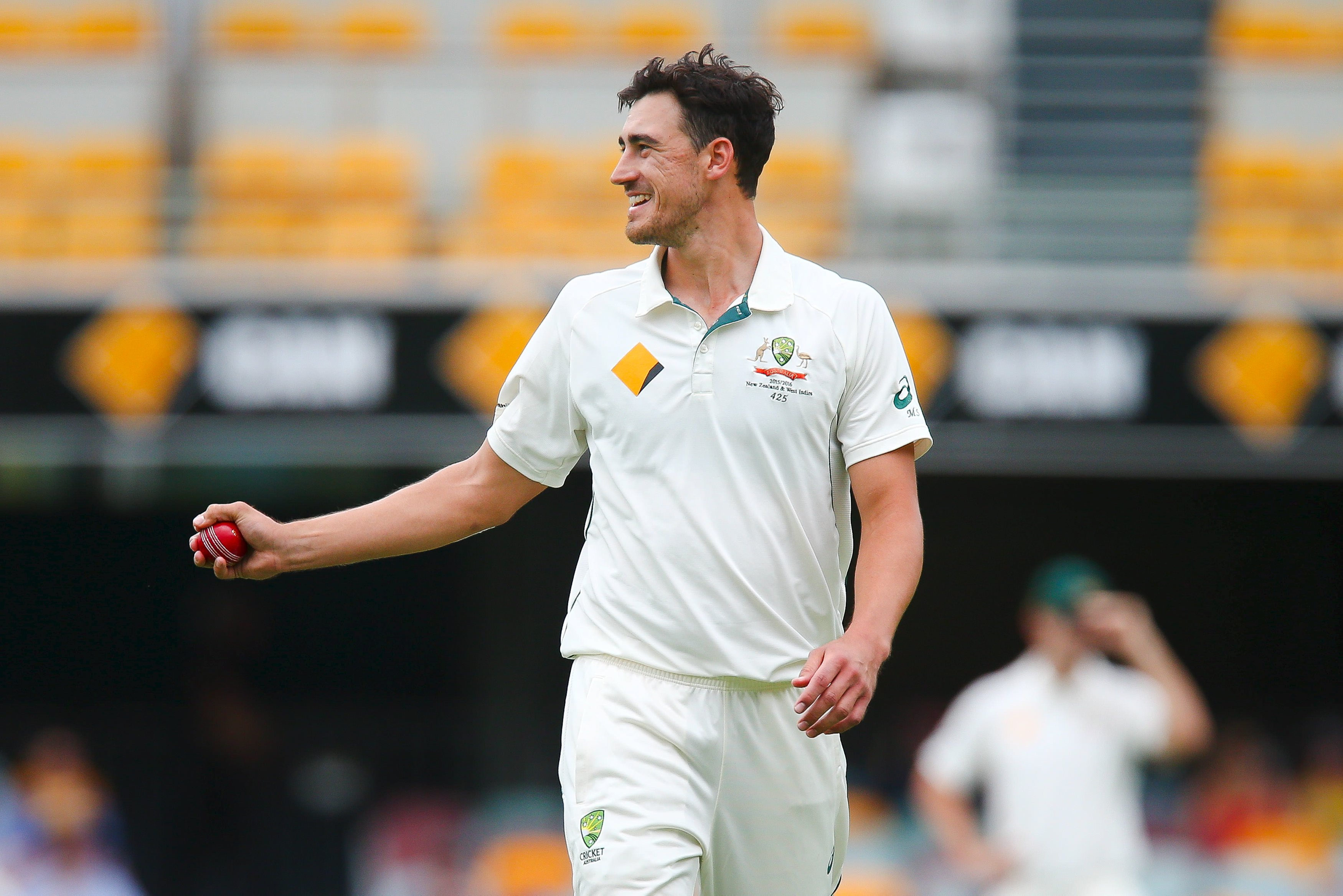 Australian bowler Mitchell Starc walks back to his mark, during the first cricket test match between Australia and New Zealand in Brisbane November 8, 2015. REUTERS/Patrick Hamilton