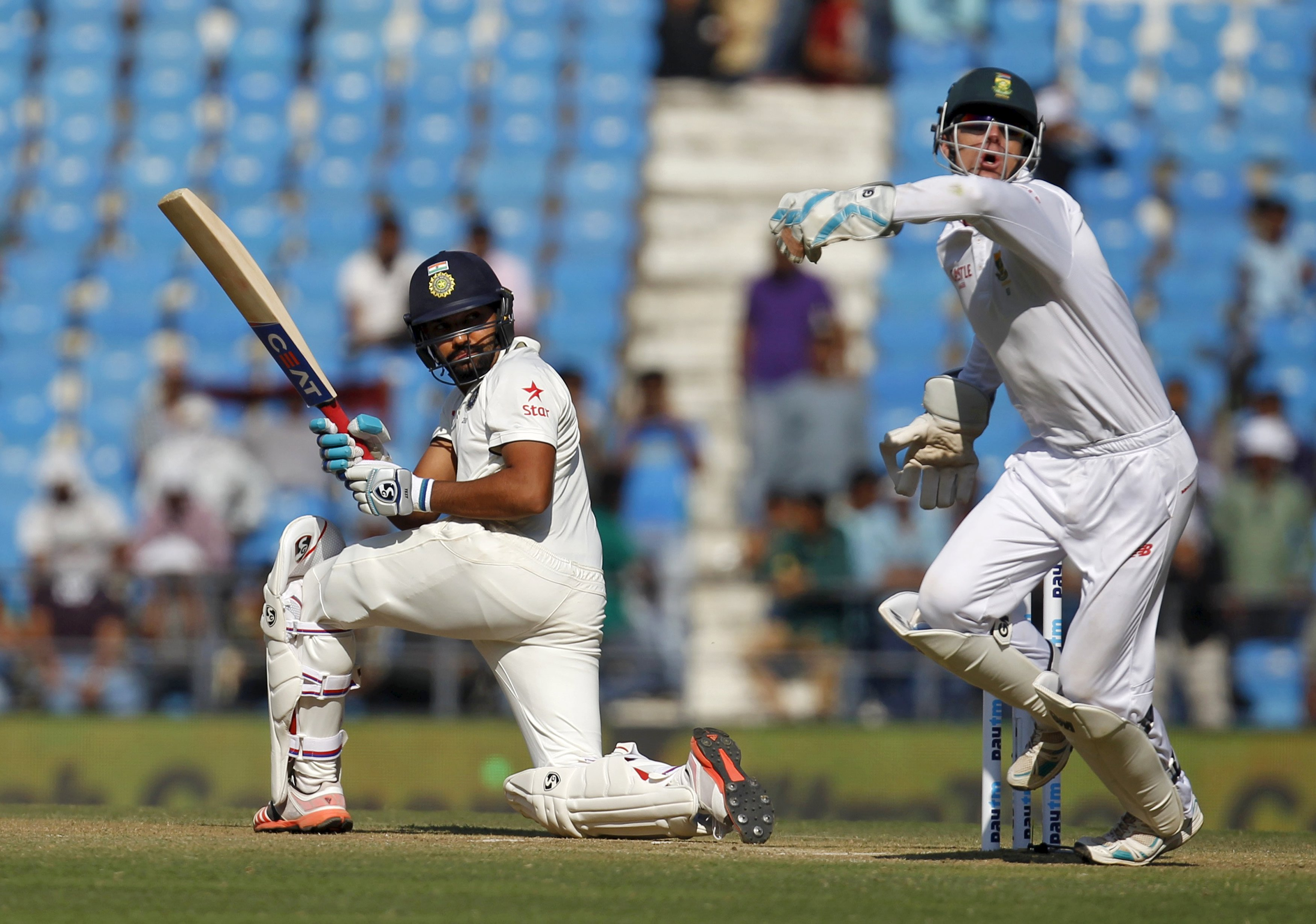 India's Rohit Sharma (L) plays a shot past South Africa's wicketkeeper Dane Vilas during the second day of their third test cricket match in Nagpur, India, November 26, 2015.  REUTERS/Amit Dave
