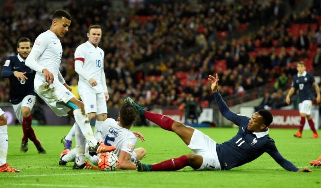 France's Anthony Martial is tackled by England's Dele Alli and Gary CahillnReuters / Dylan MartineznLivepic