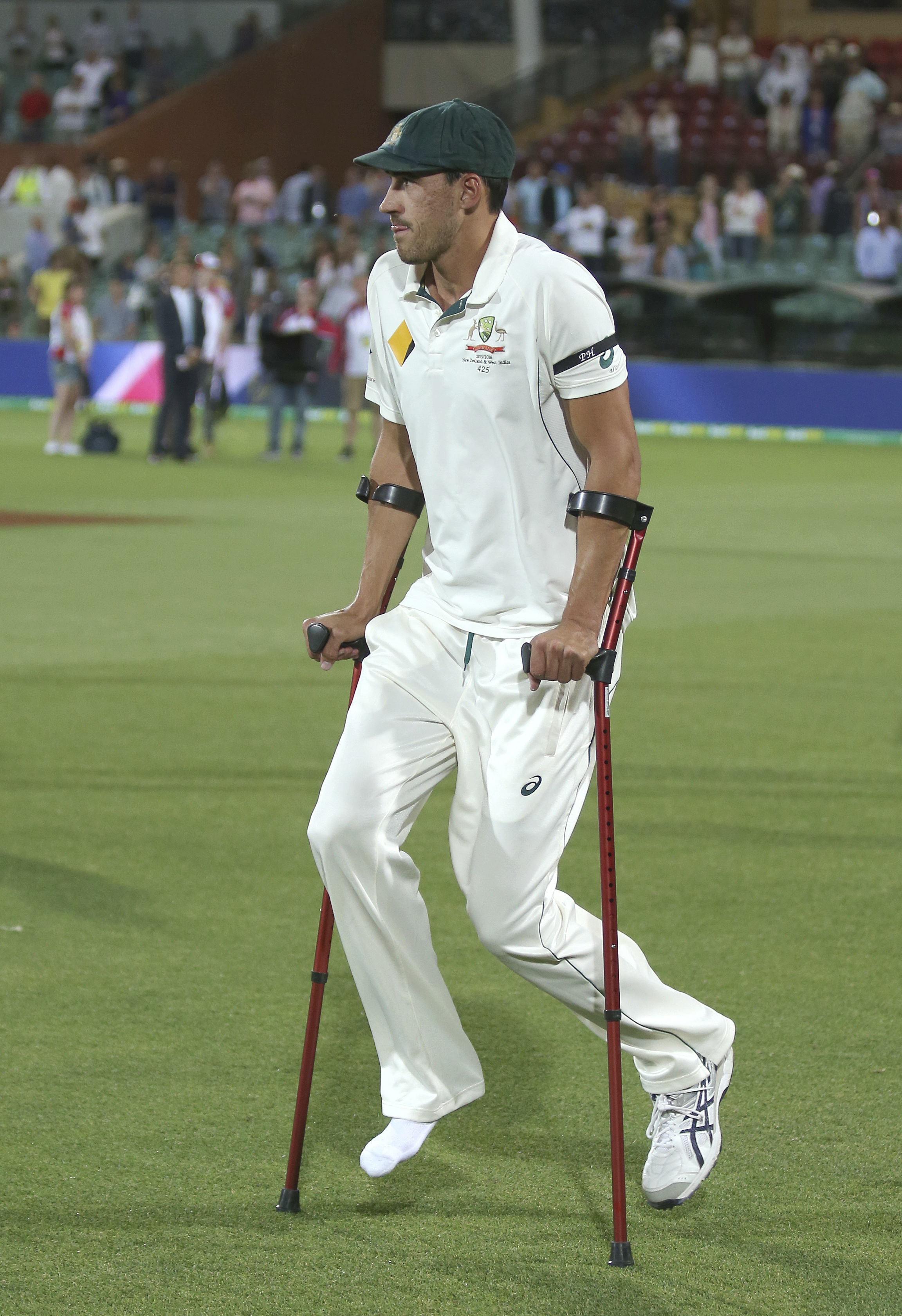 Australia's Mitchell Starc uses crutches following their cricket test against New Zealand in Adelaide, Sunday, Nov. 29, 2015. Australia won the match, the first day-night test, by 3 wickets inside of 3 days and won the series 2-0. (AP Photo/Rick Rycroft)