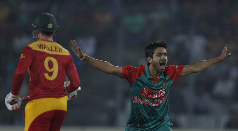 Bangladesh'u0092s Jubair Hossain successfully makes an appeal for the dismissal of Zimbabwe's Luke Jongwe during their first Twenty20 international cricket match in Dhaka, Bangladesh, Friday, Nov. 13, 2015. Photo: AP