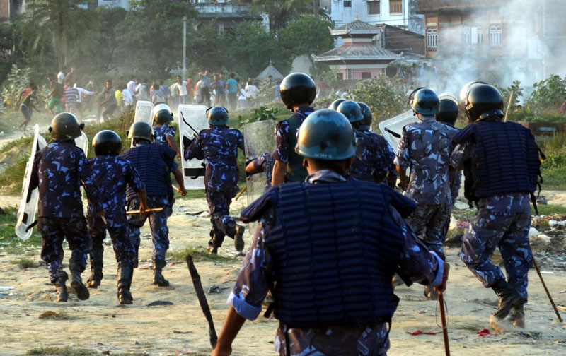Police chasing the Madhesi Front cadres during the clash that broke out between Police and Madhesi cadres in Birgunj of parsa district on Tuesday, November 3, 2015. Photo: Ram Sarraf