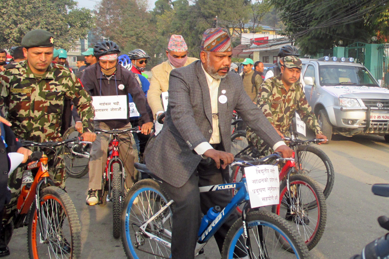 Minister for Science, Technology and Environment, Bishwendra Paswan, leads a cycle rally organised to promote electric vehicles and bicycles, in Kathmandu, on Wednesday, November 25, 2015. Photo: RSS