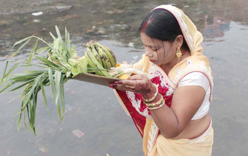 A devotee offers prayers to the Sun God while celebrating the Chhath festival in Birgunj of Parsa on Tuesday, November 17, 2015. Photo: Ram Sarraf