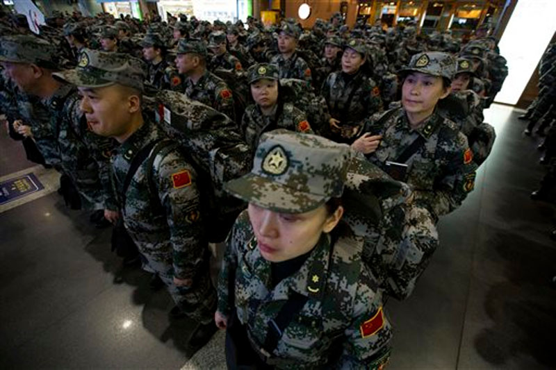 A Chinese medical contingent of more than 200 personnel, mostly from a military medical academy and several army hospitals, prepare to deploy to West Africa to help in the fight against Ebola from the airport in Beijing, China on November 14, 2014. Photo: AP