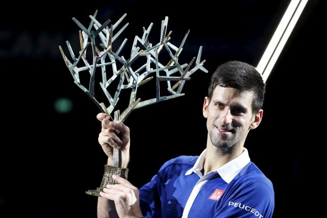 World number one Novak Djokovic of Serbia poses with the trophy after beating Britain's Andy Murray in their men's singles final tennis match at the Paris Masters tennis tournament November 8, 2015. REUTERS/Charles Platiau