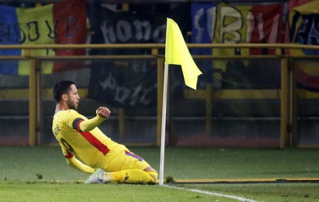 Romania's Florin Andone celebrates after scoring. Reuters/Stefano Rellandini