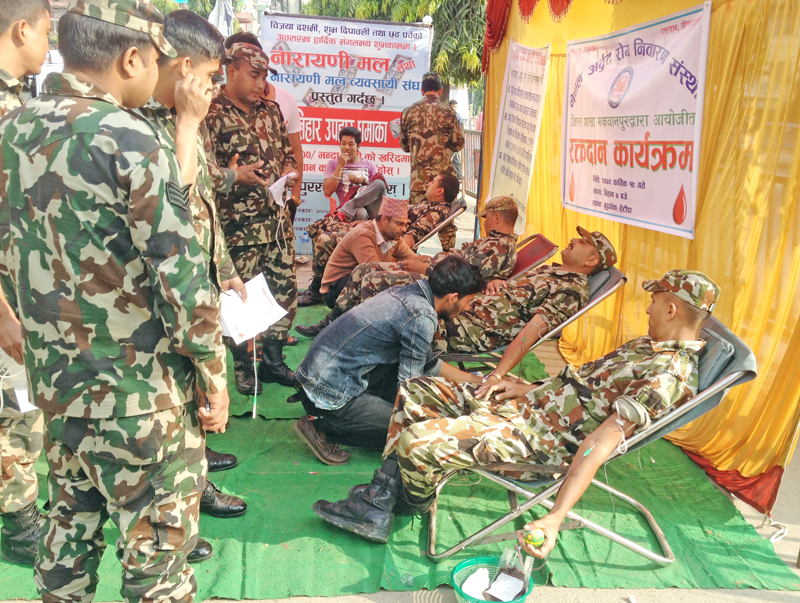 Nepali Army personnel donating blood at Nepal Cancer Disease Prevention Organisation in Hetauda, Makawanpur, on Thursday. Photo: THT