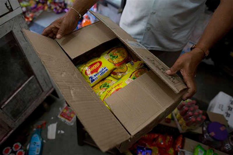 Packs of Nestle India's Maggi noodles being stored after they were removed from the shelves of a grocery store in Gauhati, India on June 5, 2015. Photo: AP