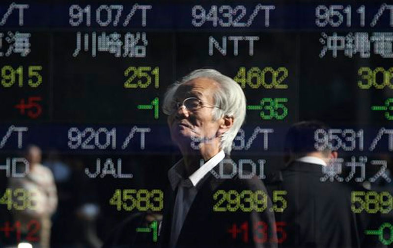 Global shares were subdued Friday ahead of a US jobs report that's likely to influence whether the Federal Reserve raises interest rates in December. Photo: AP