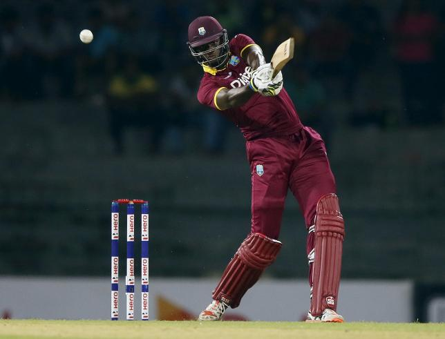 West Indies' captain Jason Holder hits a six during their first One Day International cricket match against Sri Lanka in Colombo November 1, 2015. REUTERS/Dinuka Liyanawatte