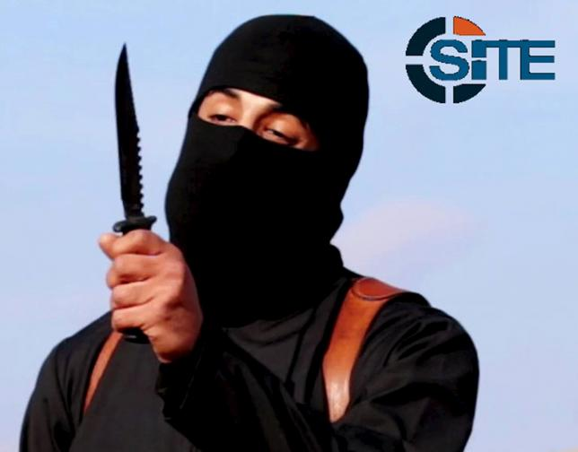 A masked, black-clad militant, who has been identified by the Washington Post newspaper as a Briton named Mohammed Emwazi, brandishes a knife in this still file image from a 2014 video obtained from SITE Intel Group February 26, 2015. Photo: SITE Intel Group via Reuters/ File