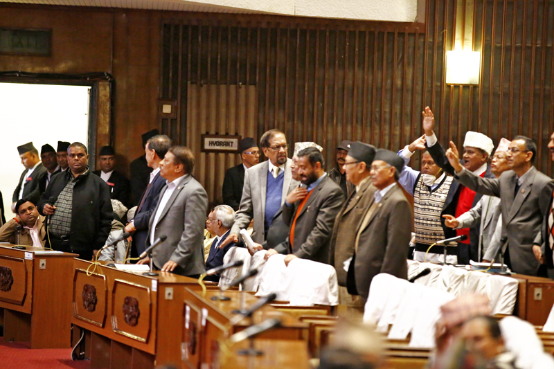 Lawmakers of opposition party Nepali Congress and United Democratic Madhesi Front (UDMF) standing up in their seats seeking permission to speak shortly after the Legislature-Parliament meeting started at the Parliament house in New Baneshwor, Kathmandu on Thursday, November 26, 2015. Photo: THT