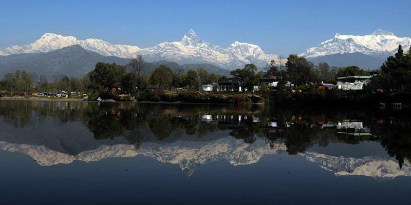 Machhapuchhre and Annapurna mountain ranges get reflected on the Phewa Lake, in Pokhara, on Saturday, November 28, 2015. Photo: Krishna Mani Baral via RSS