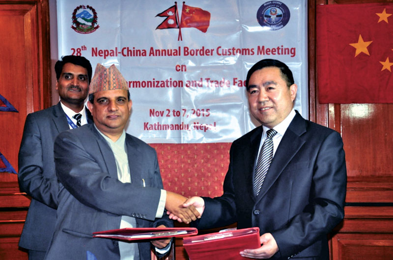Damodar Regmi, DDG of the Customs Department and his counterpart Long Chengwei, head of the Chinese delegation, after inking a 20-point deal to enhance bilateral trade, in Kathmandu, on Thursday.