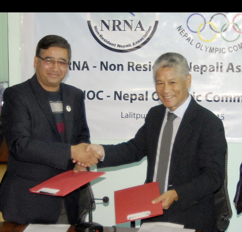 Nepal Olympic Committee President Jeevan Ram Shrestha (left) and Non-Resident Nepali Association President Shesh Ghale exchanging MoU in Lalitpur on Sunday. Photo: Naresh Shrestha/THT