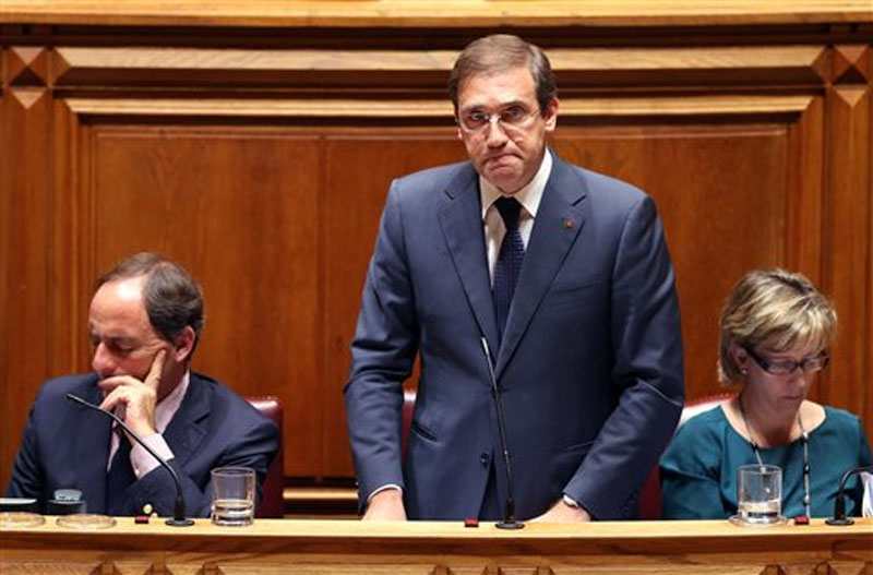 Portuguese Prime Minister Pedro Passos Coelho answers a lawmaker during the debate of the government's four-year policy program at the Parliament in Lisbon on Monday, November 9, 2015. Photo: AP