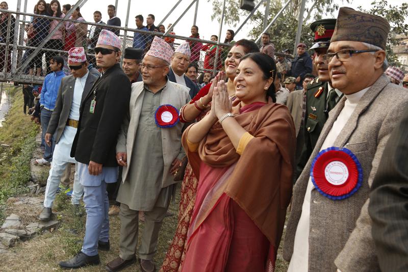President Bidya Devi Bhandari greets people after offering prayers to the Sun God, while celebrating the Chhath festival, at Guhyeshwori of Kathmandu, on Tuesday, November 17, 2015. Photo: RSS