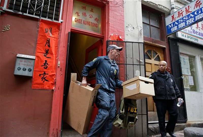 An FBI agent carries out boxes of evidence following a search of a Chinatown fraternal organisation in San Francisco on March 26, 2014. Photo: AP
