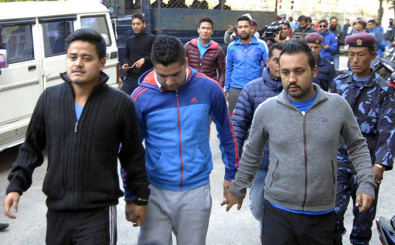 (From left) Match-fixing accused footballer Sandeep Rai, Bikash Singh Chhetri and Anjan KC being taken to Special Court along with Sagar Thapa and Ritesh Thapa (behind), on Sunday.