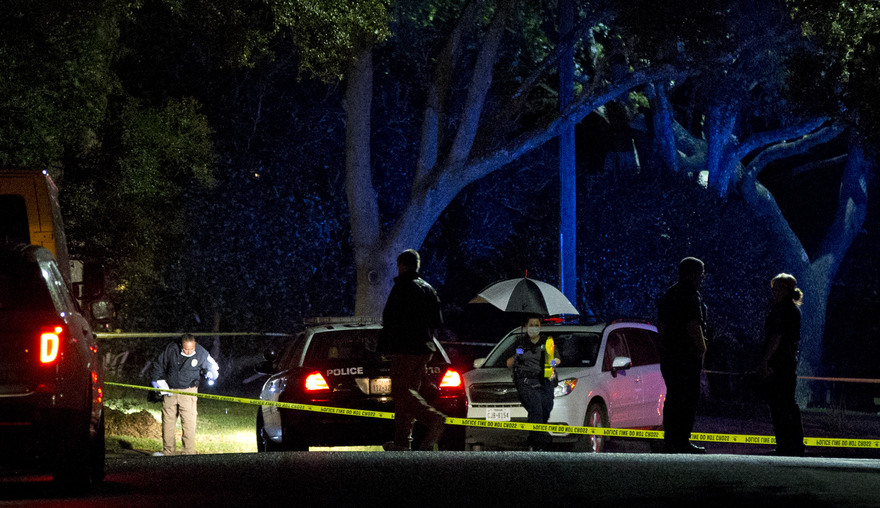 Authorities investigate the scene Saturday, November 7, 2015, where District Judge Julie Kocurek was shot on Friday night in the driveway of her home in Austin, Texas. Photo: Austin American-Statesman via AP