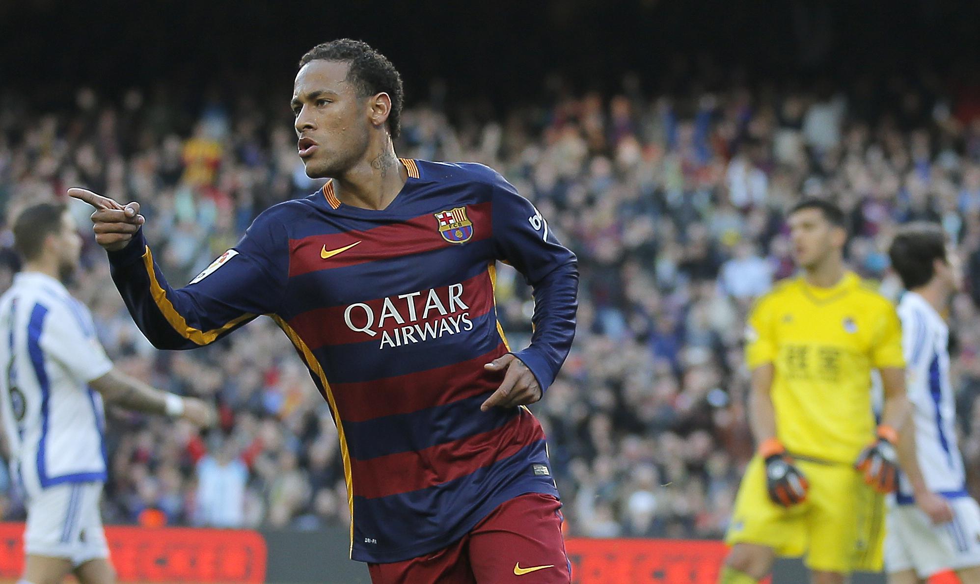 FC Barcelona's Neymar reacts after scoring against Real Sociedad during a Spanish La Liga soccer match at the Camp Nou stadium in Barcelona, Spain, Saturday, Nov. 28, 2015. (AP Photo/Manu Fernandez)