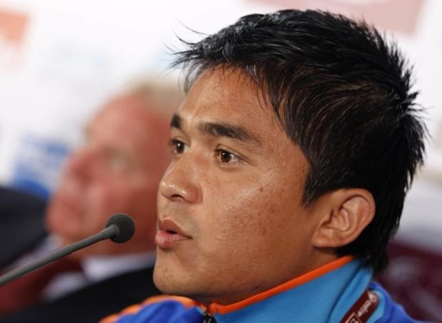 India's national soccer team player Sunil Chhetri answers a reporter's question besides his coach Bob Houghton during a pre-match news conference for the Asian Cup soccer tournament in Doha January 9, 2011.  REUTERS/Jo Yong-Hak/Files