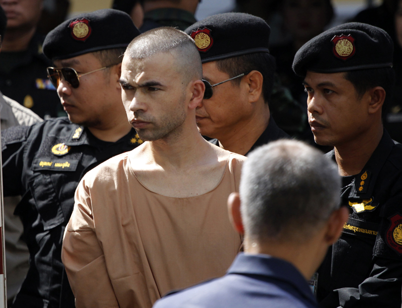 Police officers escort a suspect in the Aug. 17 blast at Erawan Shrine, Bilal Mohammad, center, on his arrival at a military court in Bangkok, Thailand, Tuesday, Nov. 24, 2015. The military court has indicted two men police say carried out the deadly August bombing at the shrine that left 20 people dead and more than 120 injured.Photo: AP