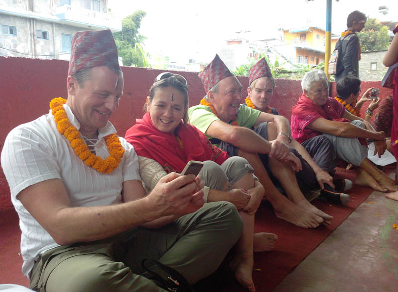 Foreigners checking their photographs after receiving Bhaitika, on the final day of Tihar festival, in Pokhara of Kaski, on Friday, November 13, 2015. Photo: Rup Narayan Dhakal
