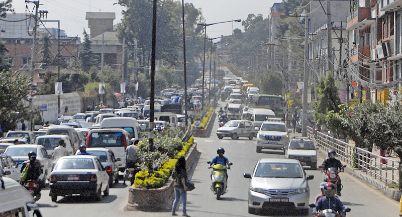 Vehicles caught in a traffic jam with many of them parked in a queue to receive fuel near a petrol pump, in Pulchok, Lalitpur, in November 2015. PHOTO: THT