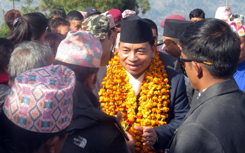 Vice-President Nanda Bahadur Pun receives welcome from members of the Magar community  at a religious function in Ramche village of Myagdi, on Wednesday, November 25, 2015. Photo: RSS