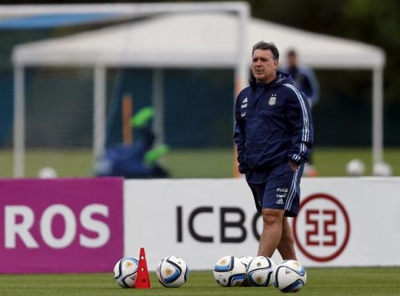 Argentina's head coach Gerardo Martino walks during a training session ahead of their 2018 World Cup qualifying soccer match against Brazil in Buenos Aires, Argentina, November 9, 2015. REUTERS/Marcos Brindicci