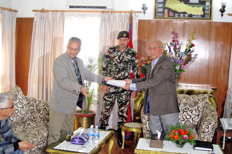 Former Prime Minister Baburam Bhattarai handing over a memorandum to the Prime Minister KP Sharma Oli in latter's residential office, Baluwatar, on Saturday, November 7, 2015. Courtesy: Baburam Bhattarai's Secretariat